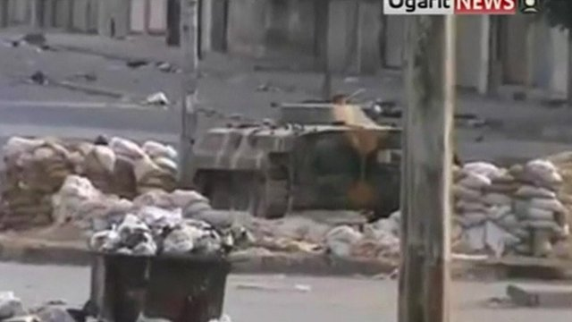 Tank on street of Homs