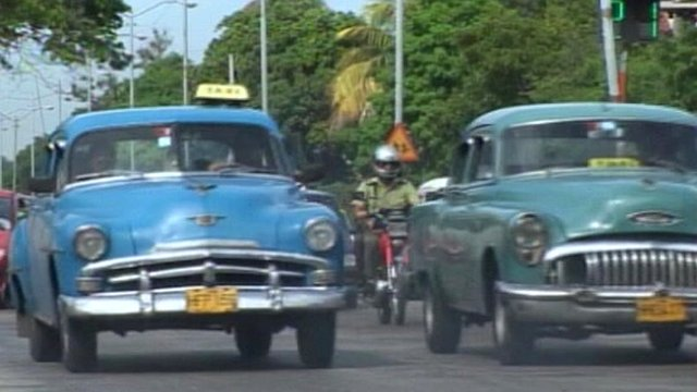 Classic cars being driven in Cuba