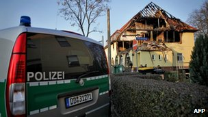 A German police car stands near the charred house in Zwickau, 11 November