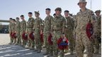 An Estonian soldier (right) stands with British military personnel during a Remembrance Sunday parade at Lashkar Gah base in Helmand province.