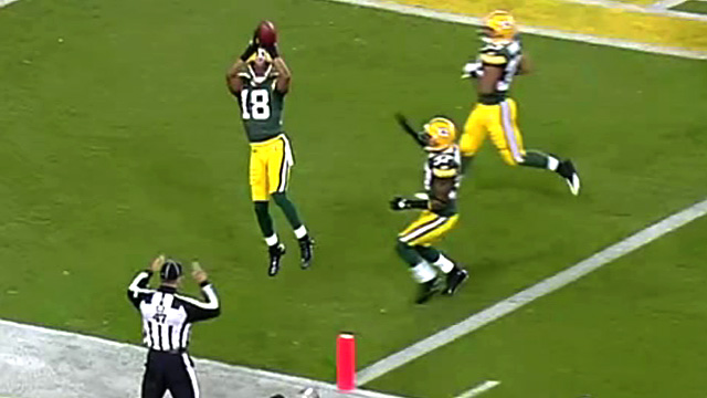 Randall Cobb of the Green Bay Packers returns a punt for an 80-yard touchdown
