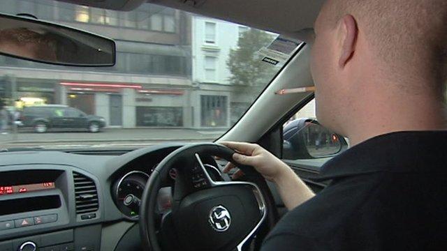 Man smoking while driving