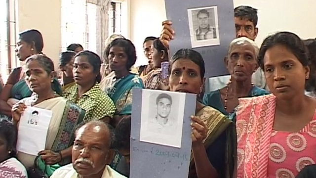 Sri Lankans holding picture of their lost relatives