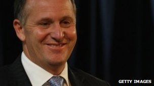 """New Zealand Prime Minister John Key speaks during the Hellensville electorate """"Meet the Candidates"""" meeting at Whenuapai Primary School on November 9"""