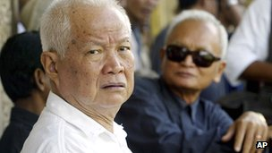 Khieu Samphan (L) and Nuon Chea (R) attend the funeral for the former wife of Pol Pot in July 2003