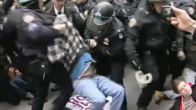 Police carrying protesters away at Occupy New York