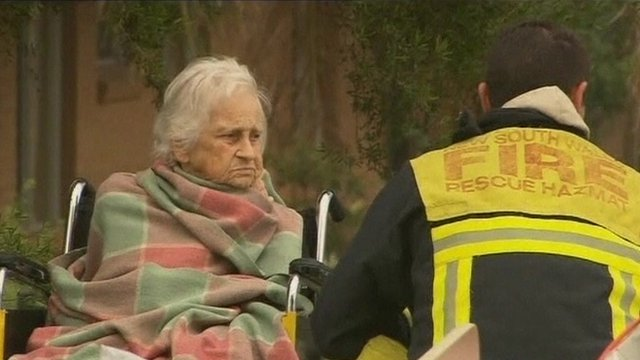 Elderly lady and firefighter