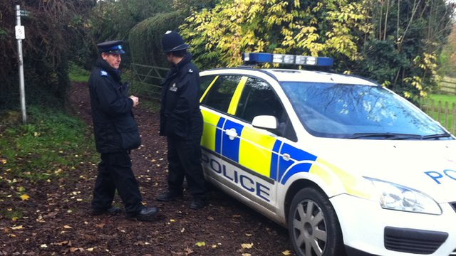 Police offices guard the entrances to a Redmarley farm which once belonged to Adrian Prout