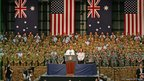 US President Barack Obama addresses troops at RAAF Darwin as Australian Prime Minister Julia Gillard looks on during the second day of his visit to Australia