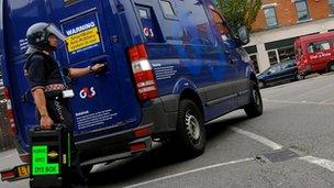 G4S van and guard