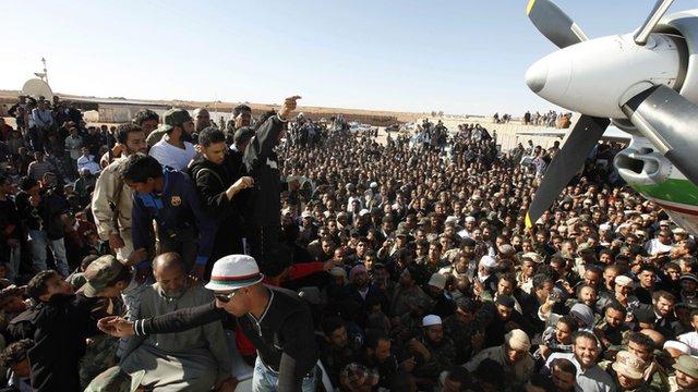 crowd of people gather at Zintan airport to see Saif al-Islam Gaddafi