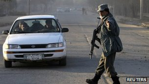 An Afghan policeman keeps watch at a vehicle checkpoint on the first day of the Loya Jirga, or the traditional assembly, in Kabul November 16, 2011