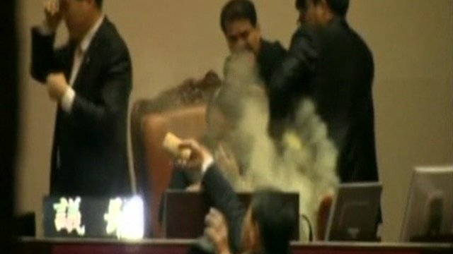 Politician throws tear-gas cannister