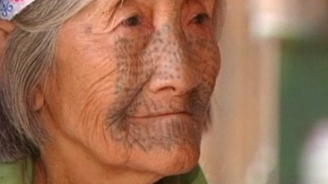 An old tattooed woman from Derung
