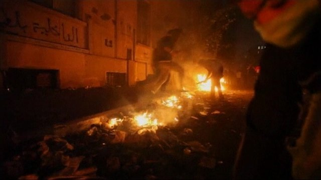 Protesters light fires in Cairo
