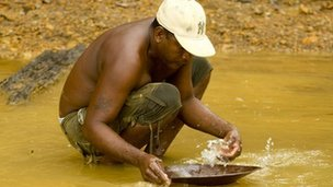 A miner panning for gold in Mahdia, central Guyana