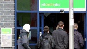 Young men enter a Job Centre