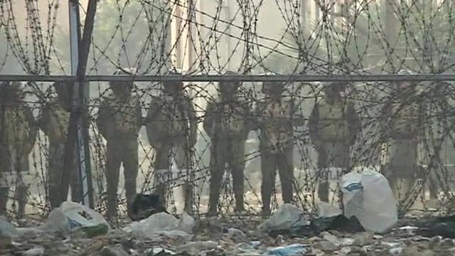 Troops behind barbed wire