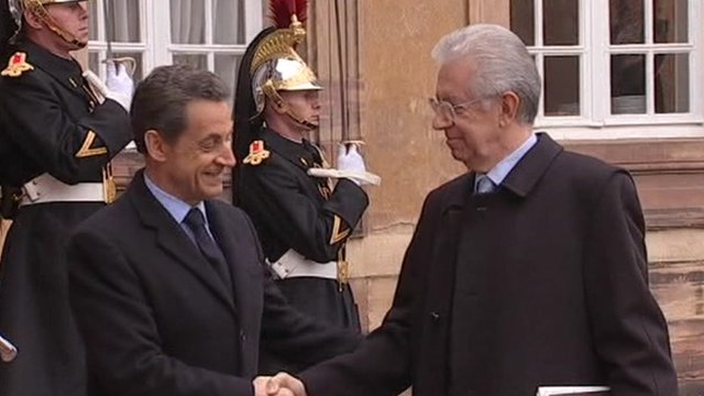 Sarkozy and Monti shake hands