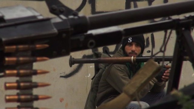Member of the Free Syrian Army with artillery.