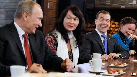Vladimir Putin (left) and Dmitry Medvedev meet women's representatives near Moscow, 25 November