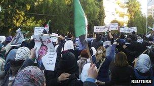 """Demonstrators protest against Syria""""s President Bashar al-Assad in Homs, 25 November 2011"""