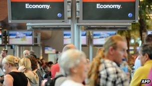 Passengers at Qantas check-in counters