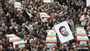 Iranians carry the picture and coffin of Hassan Tehrani Moghaddam, a Revolutionary guards commander killed in a blast near Tehran, 14 November, 2011.