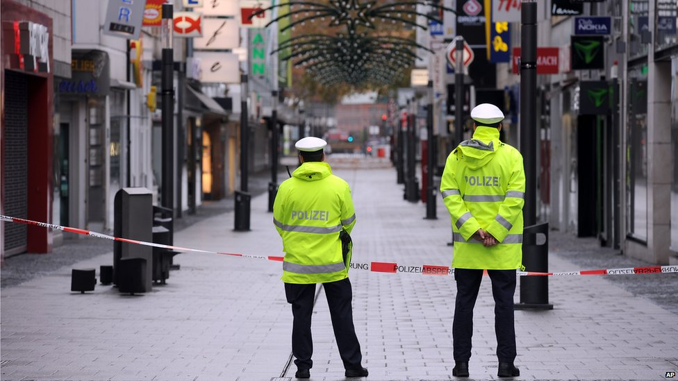 Police guard an empty shopping street in Koblenz, Germany, while a WWII bomb is defused on 4 December 2011