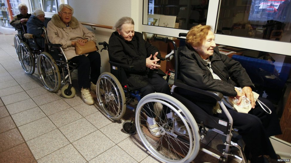 Pensioners line up in wheelchairs to be evacuated from a retirement home in Koblenz, Germany, on 4 December 2011