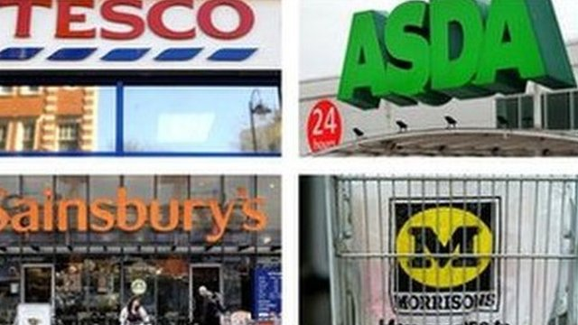 Signage for Tesco, Asda, Sainsbury's and Morrisons