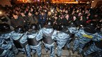 Riot police keep back protesters in central Moscow on 6 December 2011