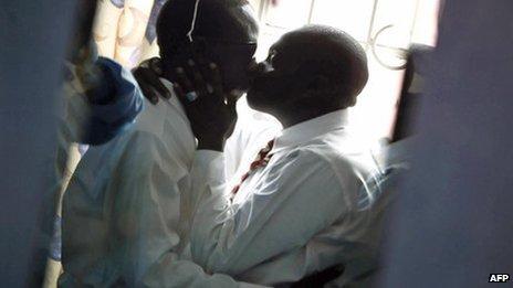 Gay men kiss in Nairobi (20 June 2006)