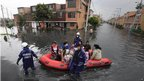 Firefighters evacuate residents in the Bosa district, in southwestern Bogota