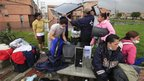 Residents of Bosa, in Bogota, try to salvage their belongings from the floods.