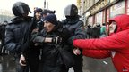 Policemen detain an activist during a rally to protest against what activists say were violations in parliamentary elections, in St Petersburg on Saturday