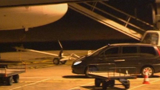 Noriega arrives in a car at Orly airport in Paris