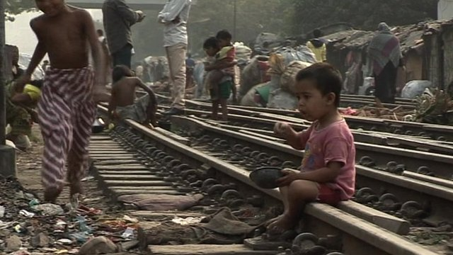 A child eats on a rail track