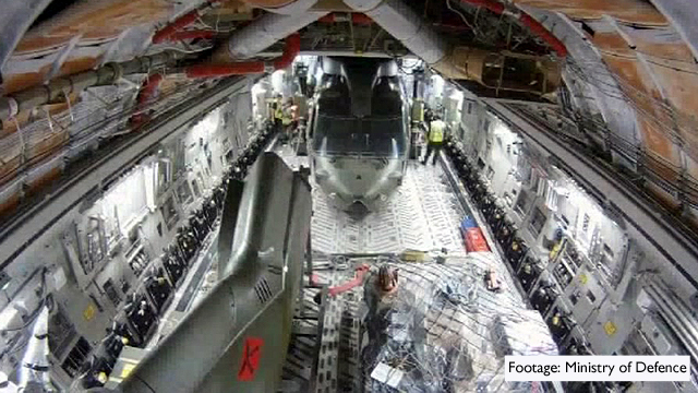 Ministry of Defence footage shows how a Merlin helicopter is moved