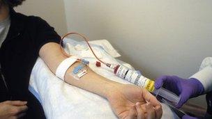 Woman receiving intravenous chemotherapy