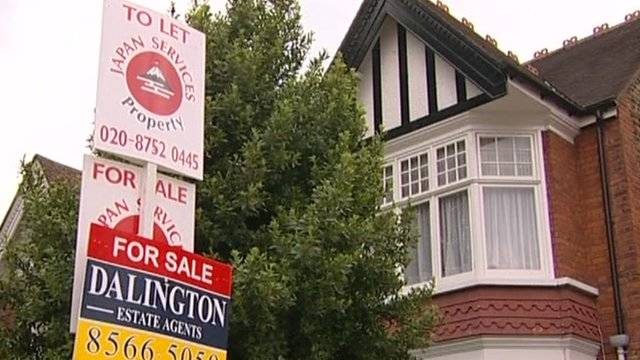 For sale signs in front of house