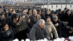 North Koreans mourn Kim Jong-il in front of the Statue of the Sun in Pyongyang (20 December 2011)