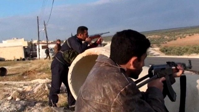 Men with weapons in Syria