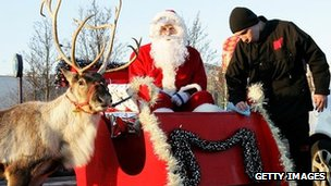 Santa in his sleigh with a reindeer