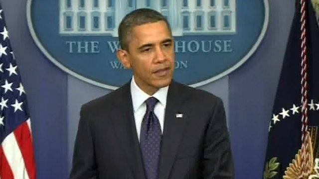 President Obama relates the tax news at a press conference.