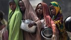Girls stand in line for food aid on 14 August 2011 in Mogadishu, Somalia
