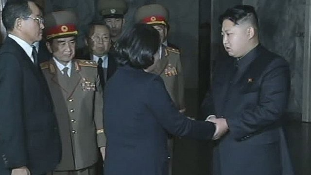 Kim Jong-un, right, late North Korean leader Kim Jong-il's youngest known son and successor, shakes hands with Hyundai Group Chairwoman Hyun Jeong-eun