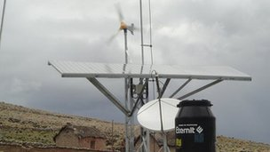 Solar panels and wind turbine in Pasiri