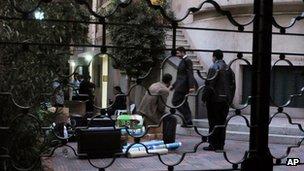 Egyptian police raid an NGO office in Cairo on 29 December 2011