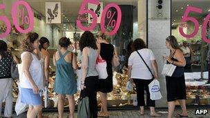 Customers outside a shop in Greece